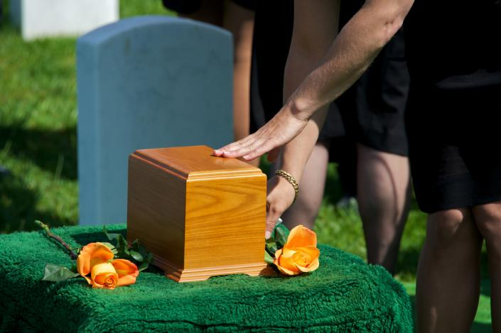 [Image: Memorial services can be used as a way to say goodbye to a loved one who has chosen cremation over the traditional funeral service]